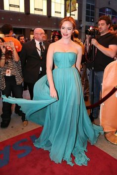 Romanian stunner Olimpia Melinte hit the premiere of Cannibal in a red carpet-kissing Maria Lucia Hohan gown. We love the side cutouts, which give the draped, teal number an edgy punch #tiff13