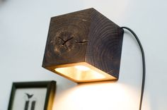 Gorgeous cube wall sconce ready to make an impact on your wall. Made of Oak wood, it has an elegant geometric design which will fit in any modern home...
