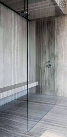 SHOWER Porcelain stone look walls and floor, with built in bench seat.