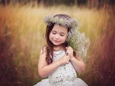 Little Fairy - ARTFreeLife - A young girl with a floral wreath on her head and more flowers in hands.