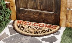 This Welcome to Our Neck of the Woods Doormat is a wonderful addition to the outdoor décor at your home.