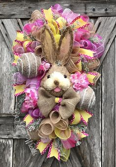 Easter Wreath, Easter Swag, Bunny Wreath, Spring Wreath, Spring Swag, Easter Door Hanging, Spring Door Hanging Here comes Peter Cottontail hopping down the bunny trail! Hippity Hop- Easters on its way! The colors of spring is so charming with this gorgeous bunny surrounded by cotton candy pink, hot pink & sunshine yellow florals, Easter sprays and beautiful ribbons. What a lovely way to greet the season! Measures XL at 32 inches in length & 22 inches wide~ ready for immediate shipmen...