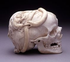Memento Mori; ivory; skull of recently deceased person; state of decomposition with skin and hair adhering; being eaten by worms, toad and l...