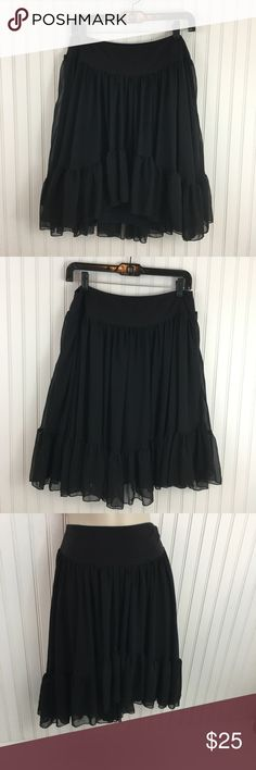 "Free People Black Boho oversized ruffle skirt Black free People skirt with ruffled hemline. High- low style full skirt. Completely lined. Elastic waistband. In very good condition no rips stains or holes Approximate measurements flat across Waist: 14.5"" length: 19.5""(front) 22.5""( back) Free People Skirts High Low"
