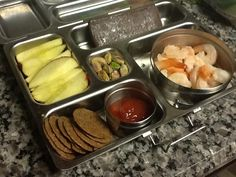 Apples, Nut Thins, cherry fruit leather, Pistacchios, and boiled shrimp w/ketchup! Someone is gonna be so happy to see shrimp ♥