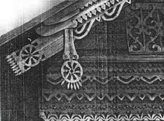 others who claim that the traditional kolovrat as seen on some Slavic houses was more like a spinning wheel (or chariot wheel).  Old photo of Slavic house decoration