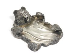 A FABERGÉ SILVER TRAY, MOSCOW, 1899-1908 realistically cast and chased as a bear skin, with red cabochon hardstone eyes, struck K. Fabergé in Cyrillic with Imperial warrant, 84 standard length 5 in., 12.7 cm