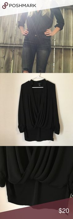 Forever 21 black dress shirt Size small FOREVER21 black dress top with a diving v neck line that twirls, so it needs a tank top underneath it. In good condition. Can be dressed down with jeans or dresses up with a pencil skirt. Forever 21 Tops Blouses