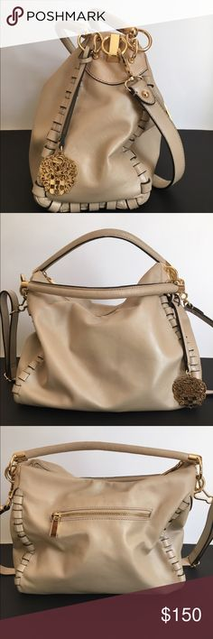 Vince Camuto Satchel Vince Camuto tan satchel. Gently used. Some wear on the handles and 3-4 ink marks on the bottom inside of bag, but still looks new. Most compliments I've ever had on a purse.  No trades please. Vince Camuto Bags Satchels