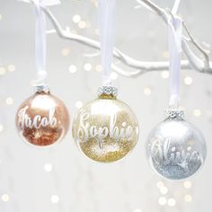 Add some sparkle to your home with these beautiful personalised glitter baubles.The glass bauble should be handled with care. Your choice of personalised message will be applied to your bauble using a white vinyl. Due to the size of the bauble, we can only allow up to 8 characters per bauble. These baubles would also make excellent place settings and potentially a dinner party favour for each guest to take home! Your bauble will be sent to you packed using lots of bubble wrap and a box to…