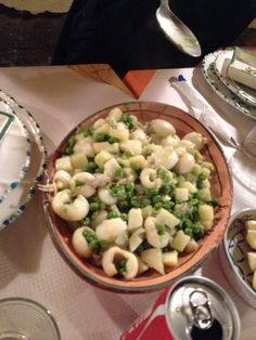 Moscardini con piselli e patate