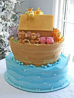 By Twos - When Emily found out she was having twins, she began to buy everything in twos. That's why a Noah's Ark themed baby shower cake wa...
