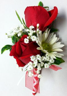 Boutonniere of red Spray roses accented by a white daisy.