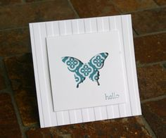 Stampin Up Elegant Butterfly Punch Card cut out with designer series paper behind and embossed card.