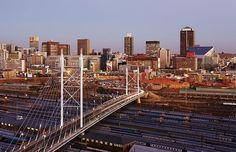 Johannesburg, South Africa - home to one of the best airports in the developed world – O. Tambo International Airport – a small city center in itself with dozens of stores and restaurants. Also home to world-class malls like Sandton City and Eastgate. Johannesburg Skyline, Cities In Africa, World Cities, Most Visited, Day Tours, Cool Places To Visit, San Francisco Skyline, The Good Place, Images