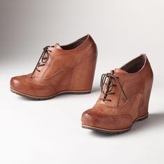 "GWENDA SHOES -- These sassy, lace up shoes from Kork-Ease® are rife with vintage charm and a clean, modern sensibility. Leather. Imported. Whole and half sizes 6 to 10, 11. 3-1/2"" heel, including hidden platform."