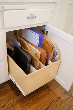 I could really use a divided pull-out drawer like this for all my cutting boards and cookie sheets! From Shawna's Glamorous Custom Kitchen featured on Kitchn.