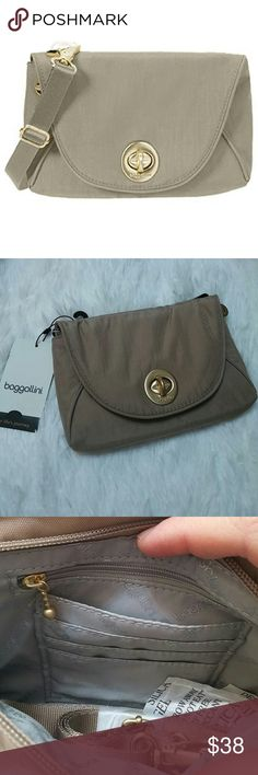 Baggallini mini seville tan The size of this bag is approximately of a wide open hand. There is a zipper and credit card pockets inside. Color is tan to cream. Baggallini Bags Crossbody Bags