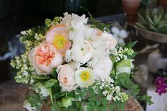 Bouquet of lilac, sweet peas, poppies, ranunculus by Garden District Memphis