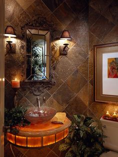 Beautiful powder room / Gorgeous small bathroom space idea with somber lighting, natural color scheme tiles and fixtures.