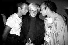 Andy Warhol flanked by Kenny Scharf, left, and Keith Haring at Elizabeth Saltzman's party