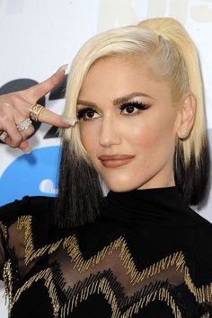 You Have To See Just How Much Gwen Stefani's Look Has Changed #refinery29 http://www.refinery29.com/2016/05/111856/gwen-stefani-makeup#slide-13 How cool is this two-toned ponytail she rocked a few weeks ago?...