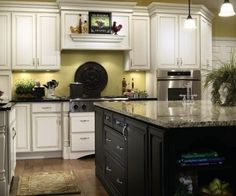 white distressed cabinets and black island