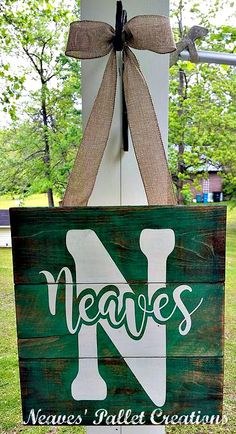 """RECYCLED WOOD PALLETS:  Everyone has a wreath or the Letter of their last name, but not too many of us have our full name done in colors of our selection. Let us customize one for you. This one is painted in teal and white and then stained. (NO vinyl.) The dimensions are 16"""" x 15"""" and hangs 26"""" by a burlap ribbon and bow. These Door Hangers will have a polyacrylic coat to help protect them. We are selling them for $36 each. Item # 934"""
