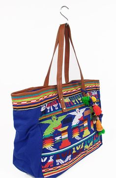 STAR MELA. Luz Em Bag.  Large shopper bag on a blue cotton base with a unique bird embroidery and leather straps - Colour - Blue/Multi. 100% Cotton.  Grande shopper di cotone blu. Ricami multicolore e cinghie di cuoio. Colore - Blu/Multi. 100% Cotone.  € 186.00