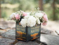 Rocky Mountain National Park Wedding Colorado Native Beer Container Holding Flowers