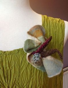 I have created a curious three dimensional shape in this Architectural piece. Made from heavy felted merino wool in gorgeous muted shades of green, blue, cream and mustard with a hint of deep maroon red and beaded with irridescent Czech glass beads on the centre piece. | eBay!