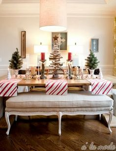 Top Coastal Beach Christmas Holiday Tables - 8 Festive Decorating Ideas  @Brooke Coniam   Can Chris make this bench, (or a version of it)  I'll upholster it!!!   I want this for my dining room table!!!!