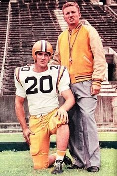 LSU retired the #20 football jersey worn by1958 All American halfback Billy Cannon. Pictured with his Coach Paul Dietzel of the LSU Fighting Tigers 1958 College Bowl Champions