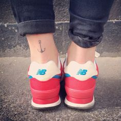 Anchor tattoo, New Balance sneakers.