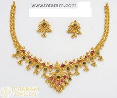 22 Karat Gold Necklace & Long Earrings set with Rubies & Emeralds and intricate workmanship. Gold Ruby Necklace, Gold Jhumka Earrings, Gold Earrings Designs, Gold Jewellery Design, Necklace Designs, Drop Earrings, Mango Necklace, Gold Designs, India Jewelry