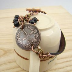 Italian coin bracelet, black leather, copper brass mixed metal, by laurelmoonjewelry, $28.00