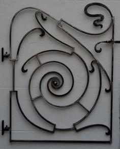 An art nouveau metal gate for a garden