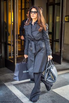 Monica Bellucci street style with trench coat