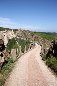 La Coupee from Little Sark, Channel Islands, UK by bob watt, via Flickr. This road did not have the side rails until German soldiers built them in WW2, local children would have had to crawl over the the bridge to the school to avoid being blown over the side. There are no cars on Sark, wonderful!