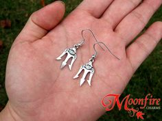 This pair of earrings is inspired by Poseidon's powerful Trident in the Percy Jackson series. The antiqued silver-plated earrings measures cm by 2 cm each. Poseidon Trident, Fandom Jewelry, Percy Jackson Books, Book Jewelry, Rick Riordan Books, Diys, Uncle Rick, Percabeth, Heroes Of Olympus