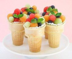 Fruit Salad Cones - Fun for party or picnic. Great idea and a good way to get kids to eat more fruit. Plus a plate saving way to serve a fruit salad~ Dessert Aux Fruits, Good Food, Yummy Food, Fun Food, Yummy Yummy, Delicious Fruit, Delicious Recipes, Delish, Best Fruits
