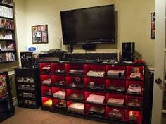 Not only do I wish I had this to hold consoles; I wish I had all of the consoles! My New Room, My Room, Spare Room, Best Gaming Setup, Gamer Setup, Ultimate Gaming Setup, Gaming Room Setup, Gamer Room, Nerd Room