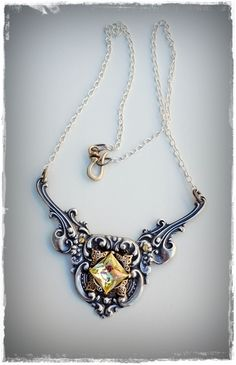Champagne winged shield necklace
