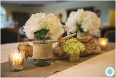 A PAWLEY'S ISLAND WEDDING - burlap, white hydrangea and candles for rustic wedding reception centerpieces // Photo by South Carolina Wedding Photographers Aaron and Jillian Photography