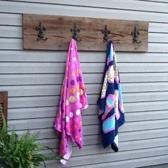 Thanks Craig for making this for me! Old cypress board with fleur de lis hooks to hang towels out by pool.