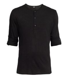 Henley shirt in cotton jersey with buttons at front. Long sleeves with roll-up tab and button.