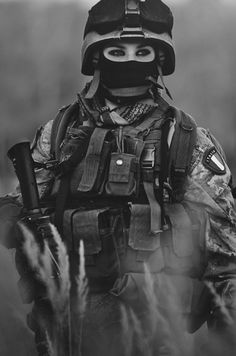 Italian Special Forces, she's wearing make up, could be a seal, getting ready… …