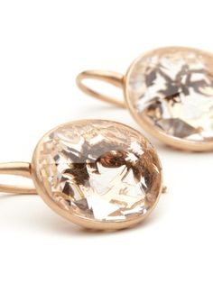 From the same collection as the exquisite pendant, these earring display the fusion of elegant metal work and modern design.  The earrings are made of 18kt matte rose gold and display an asymmetrical faceted rock crystals.  The metal work surrounding stone displays the laser cut floral design.  They measure approximately 3 cm in length.