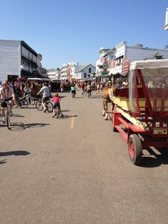 MACKINAC ISLAND, MI no cars allowed, take a ferry to the island and then ride around in horse drawn carriages!