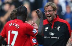 Liverpool manager Jurgen Klopp (right) celebrates the win over Chelsea with defender Mamadou Sakho